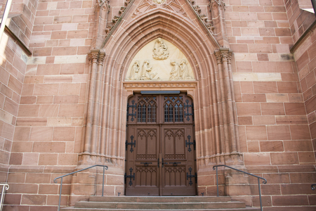 Wooden door for German people and foreigner travelers entrance in St. Gallus church for visit and praying at Ladenburg town  in Baden-wurttemberg, Germany