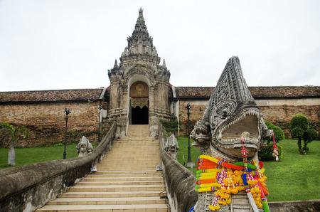 Naga statues staircase at front of gate entrane for people walking go to praying and visit chedi at Wat Phra That Lampang Luang Temple in Lampang, Thailand  Stock fotó