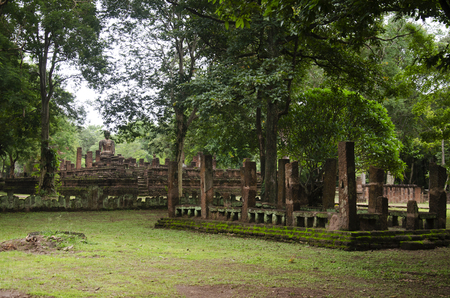 View landscape of buddha statue at Wat Phra Sing in ancient building and ruins city of Kamphaeng Phet Historical Park is an archaeological site and Aranyik Area in Kamphaeng Phet, Thailand