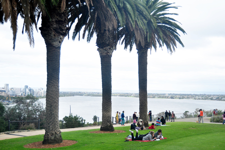 People sit relax and picnic in Kings Park and Botanic Garden near National state war memorial cenotaph commemorates Western Australian on May 15, 2016 in Perth, Australia