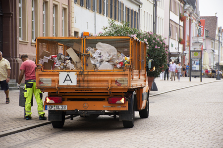 German people sweeper working clean and keep garbage and push garbage truck on the road at Speyer town on August 27, 2017 in Rhineland Palatinate, Germany