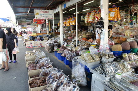 Thai people and travelers buy seafood and preserves food from vendors seafood shop at Ang Sila jetty fish local market on January 2, 2017 in Chonburi, Thailand