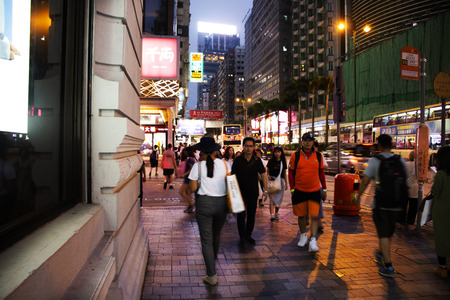 Chinese and foreigners people walking travel and shopping at Tsim Sha Tsui Centre Shopping Mall in evening at Kowloon island on September 9, 2018 in Hong Kong, China