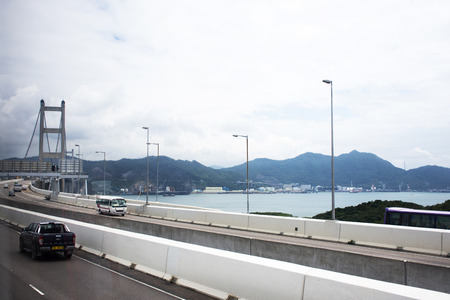 View landscape and cityscape of Hong Kong island from bus between sending people from airport to central and causeway bay on September 3, 2018 in Hong Kong, China Editoriali