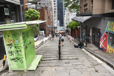 Chinese people with foreigner travelers walking travel and visit on the road at Hollywood street in Central and Sheung Wan on September 9, 2018 in Hong Kong, China