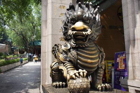 Sculpture stone Qilin dragon guardian at entrance of Wong Tai Sin Temple for people visit and respect praying at Kowloon on September 9, 2018 in Hong Kong, China