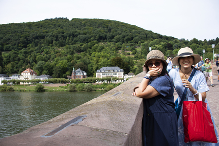 Asian thai women mother and daughter travel and posing for take photo on Karl Theodor Old Bridge at Heidelberg or Heidelberger old town in Baden-Wurttemberg, Germany 報道画像