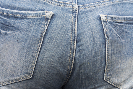 Haunches of thai woman wearing jean at Thailand