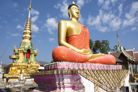 Stupa chedi and buddha statue images in Wat Phrachao Thanchai and Phra That San Kwang temple for thai people and foreigners travelers visit and respect praying at Chiangrai city in Chiang Rai, Thailand
