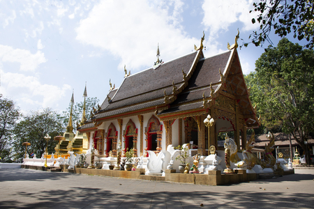 Thai people and traveler foreigner travel visit and respect praying chedi and Buddha's relics at Wat Phra That Doi Tung