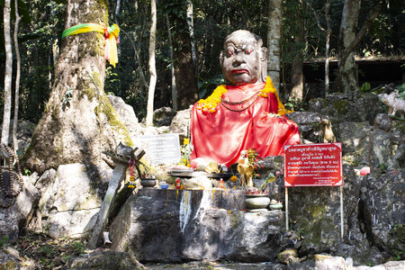 Demon or Giant angel statue in forest top of mountain for thai people visit respect praying at Wat Phra That Doi Tung on February 22, 2018 in Chiang Rai, Thailand Publikacyjne
