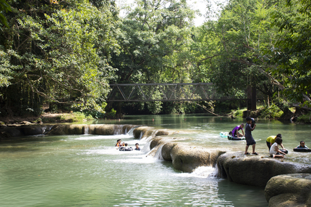 Thai people and travelers foreigner travel relax and play swimming in Namtok Chet Sao Noi small waterfall at National Park on November 13, 2018 in Saraburi, Thailand Editorial