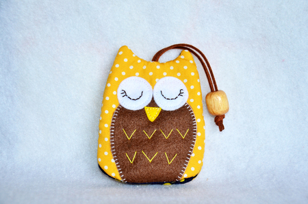 DIY handmade key cover owl doll pattern made from colorful fabric and leather and plastic beads in workshop thai style at Nonthaburi, Thailand Stock Photo