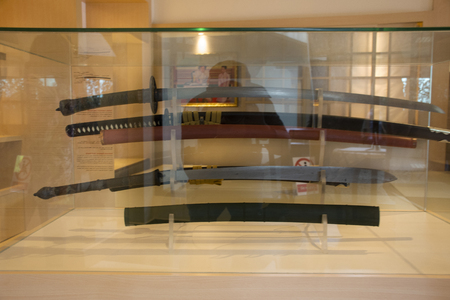 Antique samurai sword in glass cabinet for show travelers people at Japan village in Ayutthaya, Thailand Imagens
