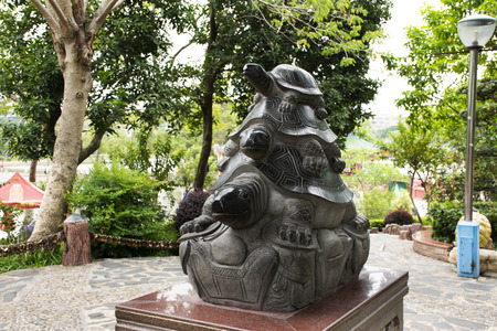 Tortoise or turtle statue for chinese people and foreigner travelers visit in garden at Zhongshan public park at Shantou or Swatow city on May 9, 2018 in Guangdong, China 에디토리얼