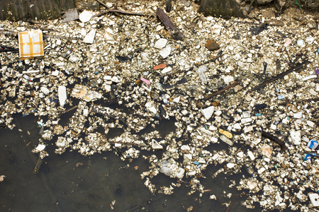 Many garbage and trash on surface of water in pond at outdoor in Shantou town or Swatow city in Guangdong, China