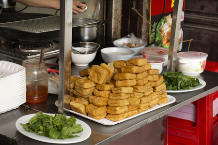 Chinese people cooking Fried Tofu with vegetables and sweet sauce for severe to customer thai people at restaurant in Chaozhou or Teochew Фото со стока