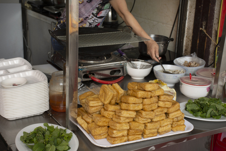 Chinese people cooking Fried Tofu with vegetables and sweet sauce for severe to customer thai people at restaurant in Chaozhou or Teochew 写真素材
