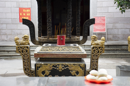 People use chinese steamed bread buns or Mantou sacrificial offering food for pray god and memorial to ancestor in Tiantan temple at Shantou or Swatow