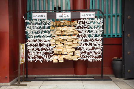 Predicted paper for answer fortune not good and people tied and drop at Marishiten Tokudaiji Temple in Ameyoko Market at Ueno city on March 30, 2019 in Tokyo, Japan