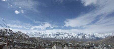 Aerial view landscape and cityscape of Leh Ladakh Village with Himalayas or Himalaya mountain from viewpoint of Leh Stok Palace Museum at Leh Ladakh in Jammu and Kashmir, India while winter season