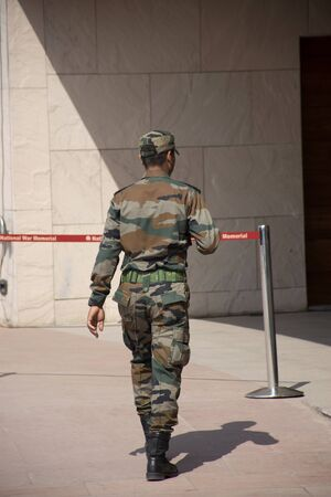 Indian soldier and police walking check and security protection around of india Gate or the All India War Memorial at city of Delhi