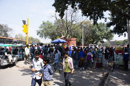 Indian people sale and buy food drink and product from local grocery small shop at beside road with traffic in morning at Delhi city on March 18, 2019 in New Delhi, India