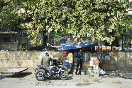 Life and lifestyle of Indian people sale and buy food drinks and products from local grocery small shop at beside road at Delhi city on March 18, 2019 in New Delhi, India Editorial