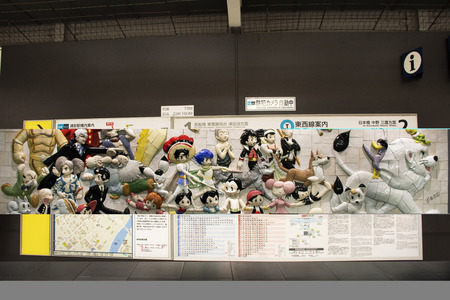 Tokyo, Japan - March 26, 2019 : Wall art anime and hero japanese style for passengers and travelers people looking visit in Ariake train JR railway Station at Koto City Редакционное