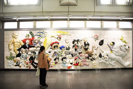 Tokyo, Japan - March 26, 2019 : Wall art anime and hero japanese style for passengers and travelers people looking visit in Ariake train JR railway Station at Koto City on March