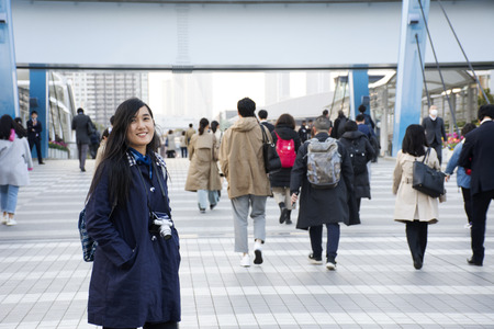 Tokyo, Japan - March 29, 2019 : Thai women and Japanese people and foreigners walking go to trains station after finished work at tokyo big sight in Ariake at Koto city
