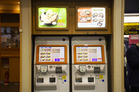 Tokyo, Japan - March 29, 2019 : Vending machine at front of udon and ramen shop for Japanese people and foreign travelers buy gourmet food and soft drink at Ariake Station