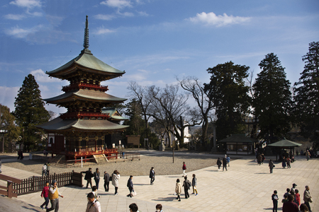 Japanese people and foreigner traveler walking visit and praying in Daitou or Great pagoda of Naritasan Shinshoji Temple at Chiba Prefecture on March 31, 2019 in Tokyo, Japan Фото со стока - 130699663