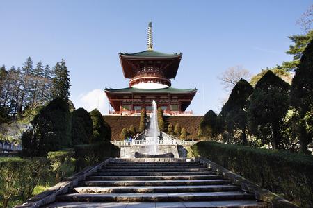 Japanese people and foreigner traveler walking visit and praying in Daitou or Great pagoda of Naritasan Shinshoji Temple at Chiba Prefecture on March 31, 2019 in Tokyo, Japan Редакционное