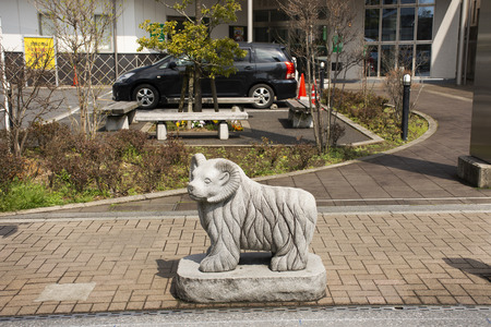 Tokyo, Japan - March 31, 2019 : Traditional japanese style rock sculpture and carving as animal stone sheep one of 12 Zodiac at beside street at Narita old town