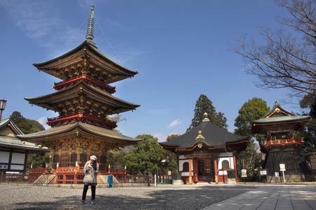 Tokyo, Japan - March 31, 2019 : Japanese people and foreigner traveler walking visit and praying in Daitou or Great pagoda of Naritasan Shinshoji Temple at Chiba Prefecture on March 31, 2019 in Tokyo, Japan Редакционное