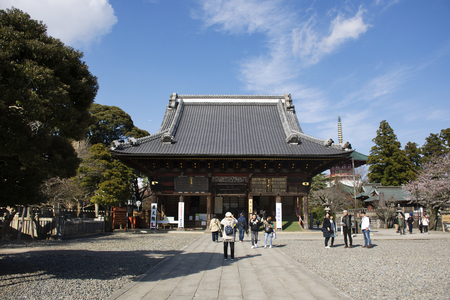 Tokyo, Japan - March 31, 2019 : Japanese people and foreign travelers walking visit and praying god angel in Great pagoda of Naritasan Shinshoji Temple at Chiba Prefecture on March 31, 2019 in Tokyo, Japan