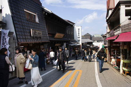Tokyo, Japan - March 31, 2019 : Japanese people and foreign travelers walk shopping and travel visit in street market of Naritasan Omote Sando or Narita old town at Chiba on March 31, 2019 in Tokyo, Japan Editorial