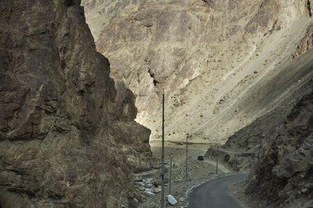 Be careful stone slide landslide on the road between Diskit - Turtok Highway and Pangong lake road go to Pangong Tso high grassland lake while winter season at Leh Ladakh in Jammu and Kashmir, India