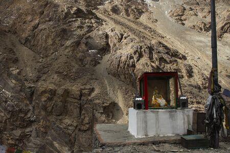 Small shrine tibetan style for people praying at beside Diskit Turtok Highway and Pangong lake road go to Pangong Tso high grassland lake while winter season at Leh Ladakh in Jammu and Kashmir, India Zdjęcie Seryjne