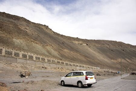 Travelers people and driver stop car in parking at outdoor of viewpoint Confluence of the Indus and Zanskar Rivers while winter season at Leh Ladakh in Jammu and Kashmir, India