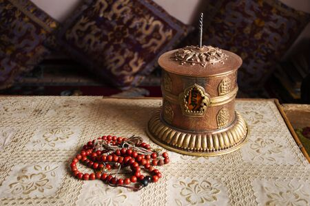 Tibet prayer wheel mantra mobile on carpet for tibetan people for respect praying buddha in house at Leh Ladakh city in Jammu and Kashmir, India