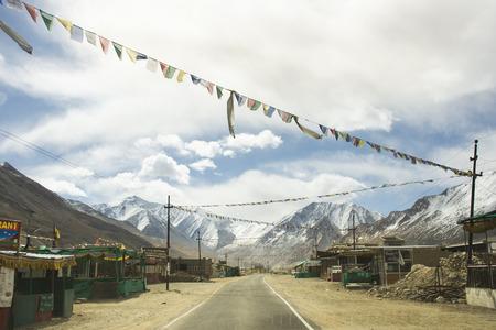 JAMMU KASHMIR, INDIA - MARCH 20 : Tibetan and indian people walking beside road of Tsati village on khardung la pass while winter season at Leh Ladakh on March 21, 2019 in Jammu and Kashmir, India Редакционное