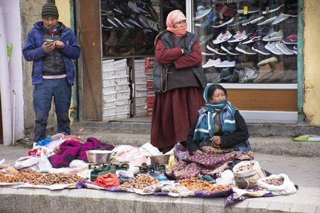 JAMMU KASHMIR, INDIA - MARCH 19 : Indian tibetan and traveler foreigner walking travel visit and sale buy product in Leh main bazaar at Leh Ladakh village on March 19, 2019 in Jammu and Kashmir, India Editoriali