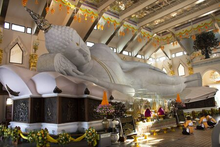 UDONTHANI, THAILAND - DECEMBER 18 : Large reclining Buddha marble statue for people and travelers travel visit and respect praying at Wat pa phu kon temple on December 18, 2019 in Udon Thani, Thailand