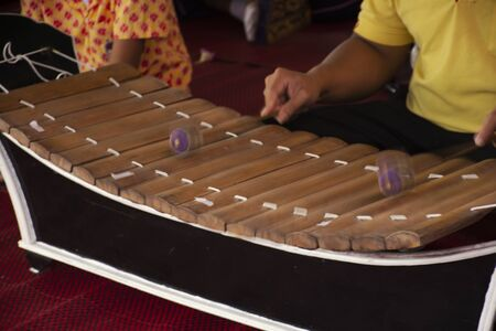 Thai people playing Ranat ek or xylophone traditional thai musical instruments concert show people in culture festival at Wat Sai Yai in Nonthaburi, Thailand