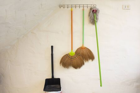 Cleaning equipment hanging at wall for waiting people use at resort of countryside Thailand Stok Fotoğraf