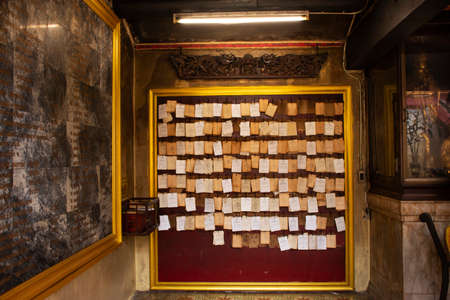 PATTANI, THAILAND - August 16 : Predicted paper for answer of Fortune Stick or Seam-si or Kau cim for people shak and ask at Chao Mae Lim Ko Niao Chinese Shrine on August 16, 2019 in Pattani, Thailand Editorial