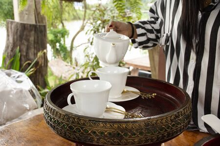 Appetizer and teapot cup set for tea time to travelers and guest in dining terrace outdoor of restaurant at resort hotel in Thailand Reklamní fotografie