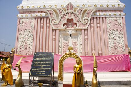 Pink and white color pagoda or stupa of Wat Phra That Renu Nakhon temple for people travel visit and respect praying